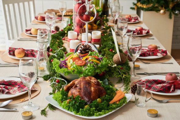 Food and decorations on Christmas dinner table